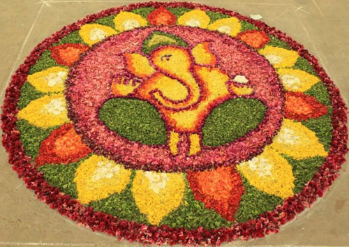 Ganesh ji rangoli with red, yellow and green colours | South Indian decor | pooja decor ideas| Ganesh Chaturthi ideas | amazing Ganesh idols