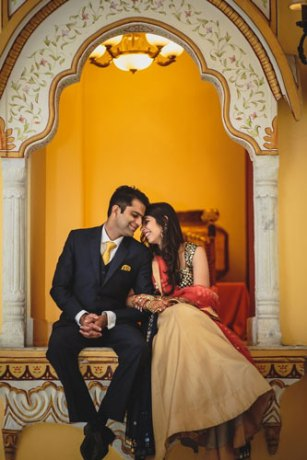 Nimisha and Hemant | Temple wedding in Delhi | The bride and the groom sitting together and seeing in each other's eyes in a beautiful backdrop.