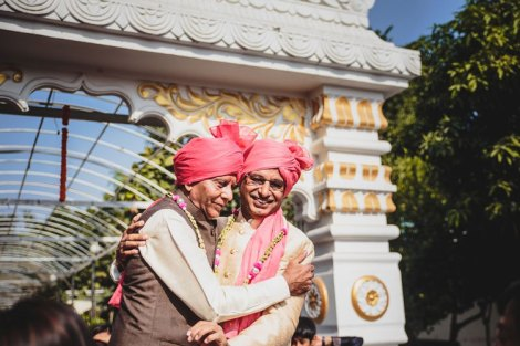 Nimisha and Hemant   Temple wedding in Delhi   The guests sharing a happy moment with milni malas.