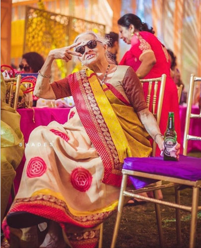 rain on your wedding day | cool indian grandmother at a wedding