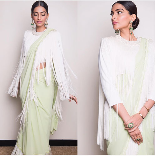Bridesmaid's Dress ideas bollywood flaunted a.k.a Totally trending Wedding Outfit ideas for the Bride's Best friend | Sonam Kapoor in a lime green pastel Abu Sandeep saree with a tassel blouse in white
