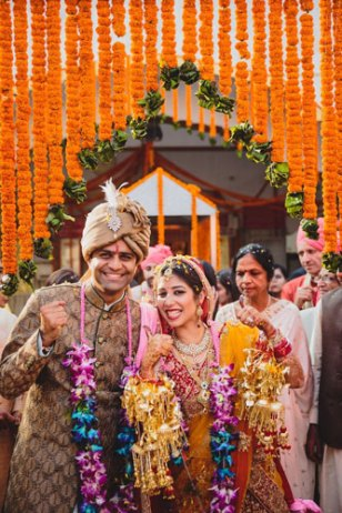 Nimisha and Hemant | Temple wedding in Delhi | The bride and groom showing their happiness after the wedding rituals.