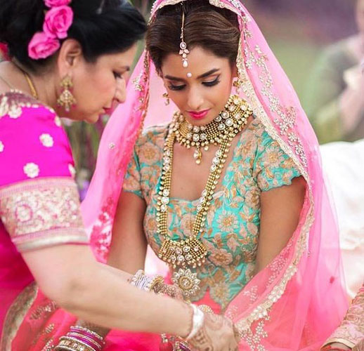 bride in a pink and blue lehenga |  Bridal lehengas colours perfect for the Indian skin tone