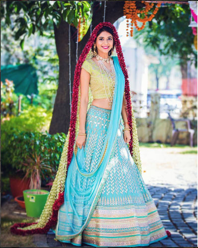Indian bride wearing a blue and silver lehenga with a gorgeous flower dupatta | floral fashion | amazing new ways to wear flowers at your wedding