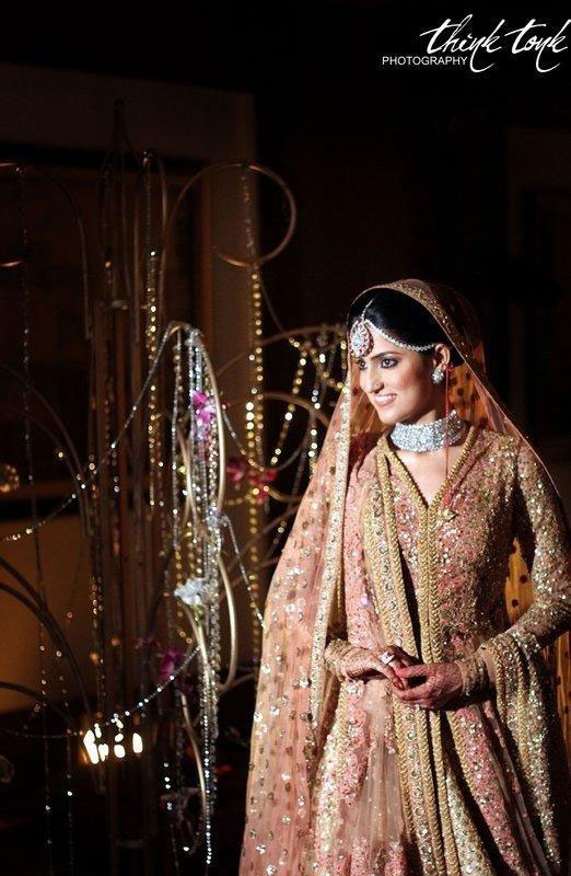 Indian bride in a peach and gold lehengas with diamond jewellery