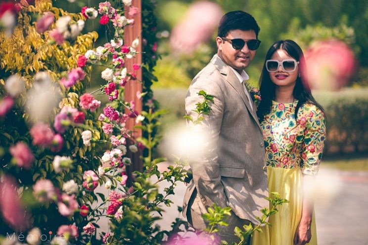 Khushboo and harshang - Gujarati wedding with fun wedding ideas | bride in a yellow gown with a pretty flower background