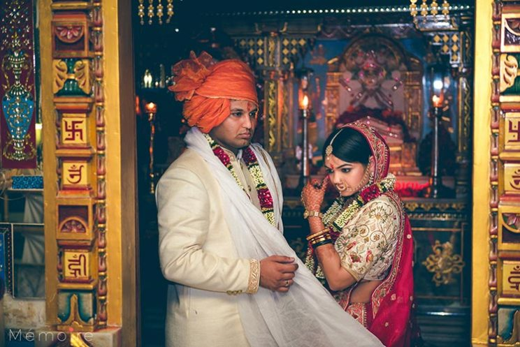 Khushboo and harshang - Gujarati wedding with fun wedding ideas | bride in a creme and red lehengas with the groom in a creme sherwani and orange saafa