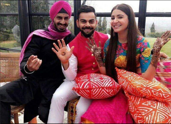 virat kolli and anushka sharma wedding in Tuscany | Anushka sharma in a pink and orange Sabyasachi skirt and elbow sleeve blue printed top by sabyasachi
