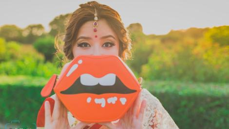 Bride holding lip pouch | #TrendingAF – Best Bridal Lipstick Shades to be a pouty bride!