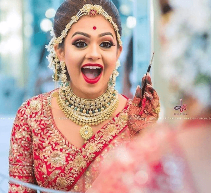 Bride in red | #TrendingAF – Best Bridal Lipstick Shades to be a pouty bride! | Bridal Lip Colors