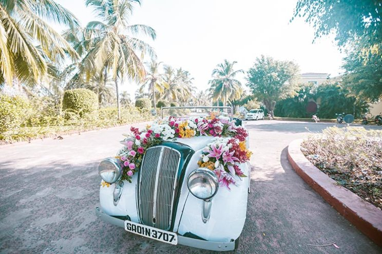 a decorated vintage car for the couple exit