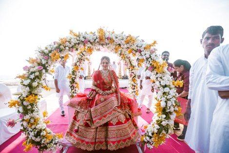 Bridal entry on a floral doli | Dubai wedding by crayon entertainment
