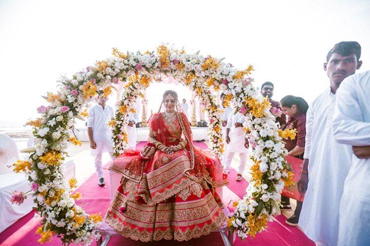 Bridal entry on a floral doli | Goa wedding by Krayonz entertainment