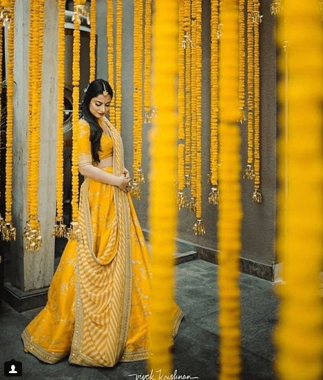 Bride in yellow on haldi | Creative Haldi ideas - 5 ways to Make your Haldi Happy & High