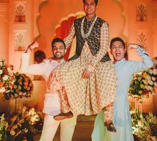 Abheshek & Smily - A Chandigarh Wedding full of fun photo | Sabyasachi Sherwani | Groom photo ideas for indian wedings | Groom on friends shoulders for wedding | printed sabyasachi weddng outfit with waistcoat