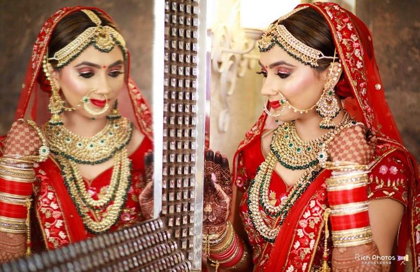 Meghna Sadhwani | Getting ready photo shoot of bride | bridal photo shoot | Bridal Swag | Bridechilla | Swagger Bride | Personalized accessories | Mirror shots | red Lehenga | Choora | Mirror Shots |