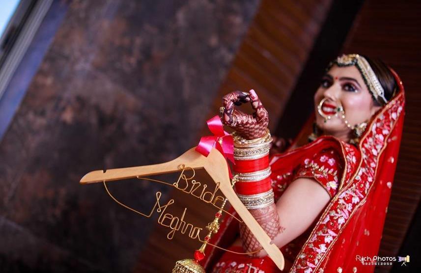 Meghna Sadhwani   Getting ready photo shoot of bride   bridal photo shoot   Bridal Swag   Bridechilla   Swagger Bride   Personalized accessories   Red Lehenga   peresonalised Hanger   Chooda  