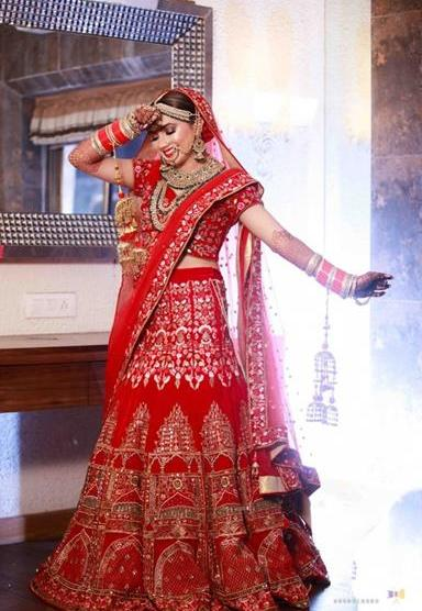 Meghna Sadhwani | Getting ready photo shoot of bride | bridal photo shoot ideas | Bridal Swag | Bridechilla | Swagger Bride | Personalized accessories | Red Lehenga | Bridal Look inspiration |