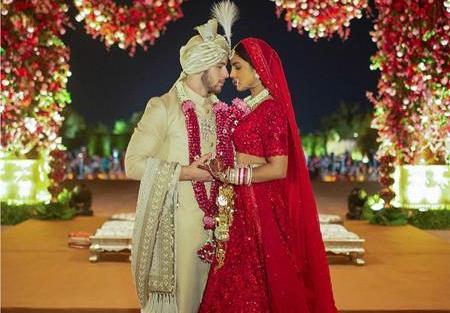 Priyanka Chopra and Nick Jonas   Priyanka Chopra in red sabyasachi lehenga   Brides of Sabyasachi   Custom sabyasachi lehenga  