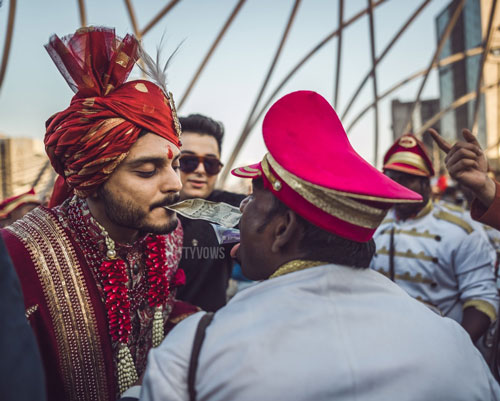 indian groom dancing with the band walas