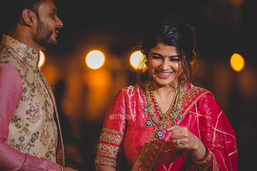 bride in a red traditional blouse and Kundan jewellery