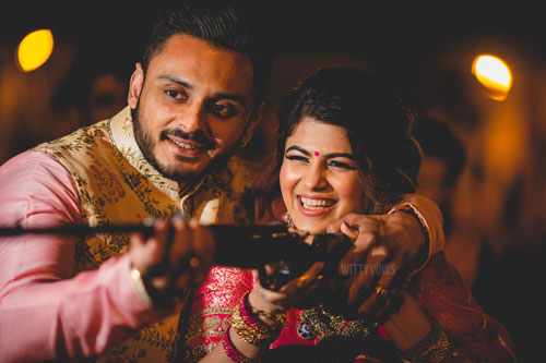 Wedding in Ahmedabad | bride in a red traditional blouse | mela themed party Steffi & Zeel