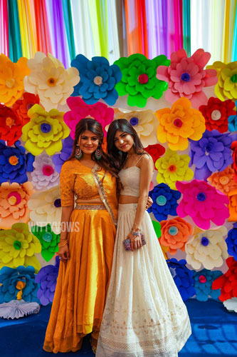 Wedding in Ahmedabad | Colourful Holi Party | Steffi & Zeel | floral wall for photo booth | paper flowers
