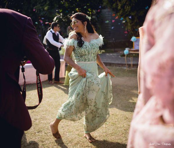 pretty indian bride in a pastel green jumpsuit at her destination wedding in Jim corbett
