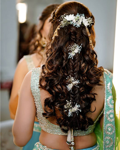 beautiful curled half upto with a fishtail braid in teh centre Diwali party hairstyles