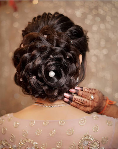 curled rose bun with dispersed pearls