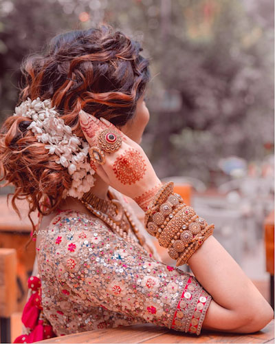 beautiful messy bun with bajra Diwali party hairstyles