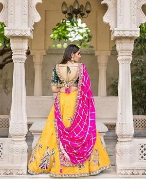 Yellow and pink lehenga | Bridal inspiration | Bridal look | Wedding lehenga inspiration | Wedding dress | Gujurati designers | Must have wedding lehehnga