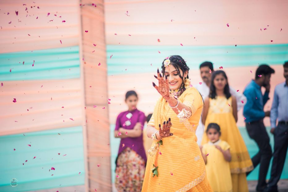 bride dancing on her haldi ceremony | A beautiful love story of Stuti and Mukul, the high school sweethearts.