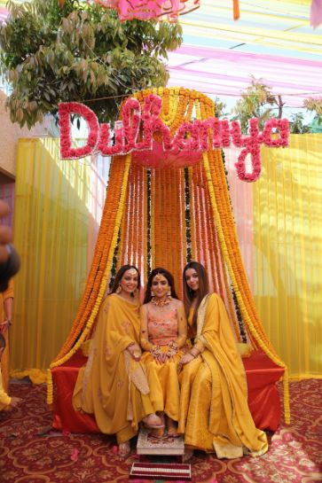 bride posing with her bffs on her haldi day | Karishma & Pratham - a love story of two advocates