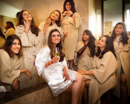 destination ideas for a bachelorette part | girls having spa and sipping vine