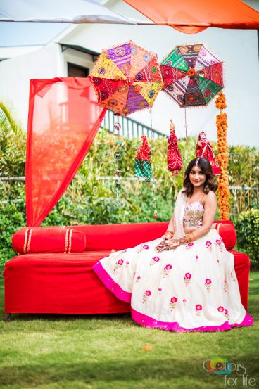indian bride at her mehendi cere mony |Bridal Lehenga Designed by the Bride