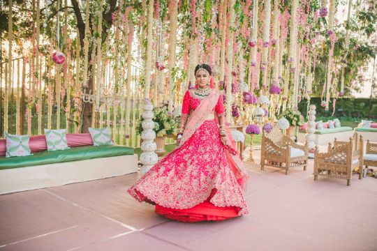 twirling bride | Sabyasachi Lehenga for Mehendi
