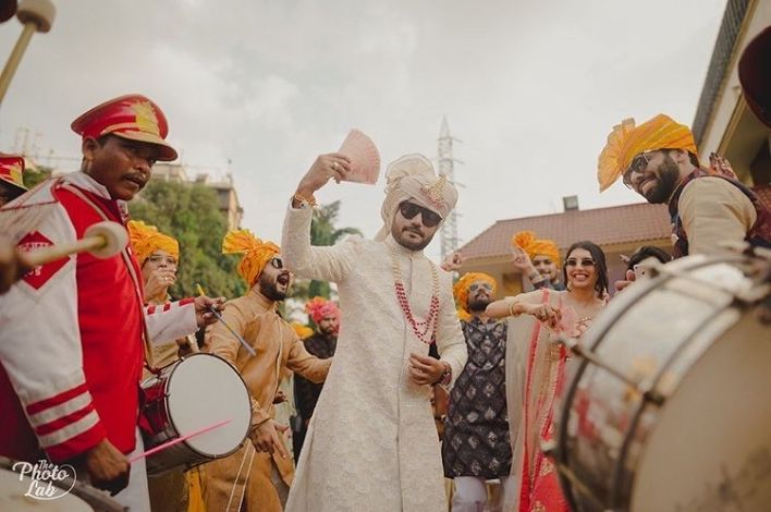excited groom entry