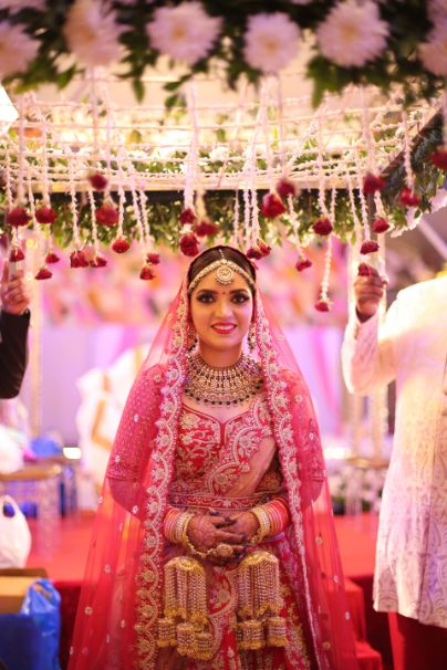 bride walking under phoolon ki chadar