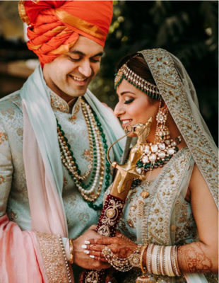 indian bride and groom in matching powder blue outfits