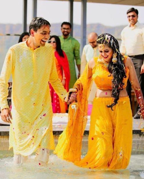 candid couple shot on haldi day