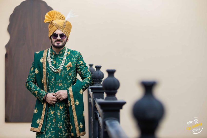dapper groom in green