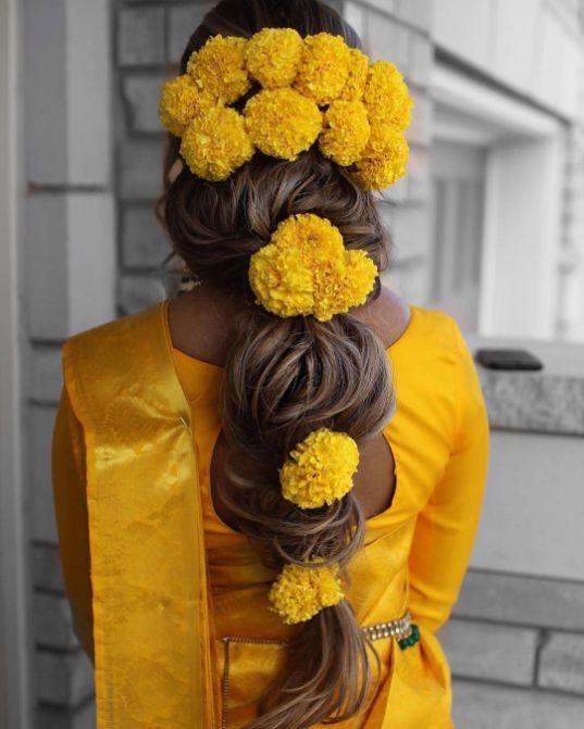 stunning marigold hairstyle \ Wedding Trends for Haldi Ceremony