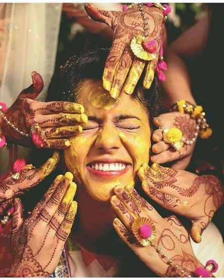 haldi application on the bride | Wedding Trends for Haldi Ceremony