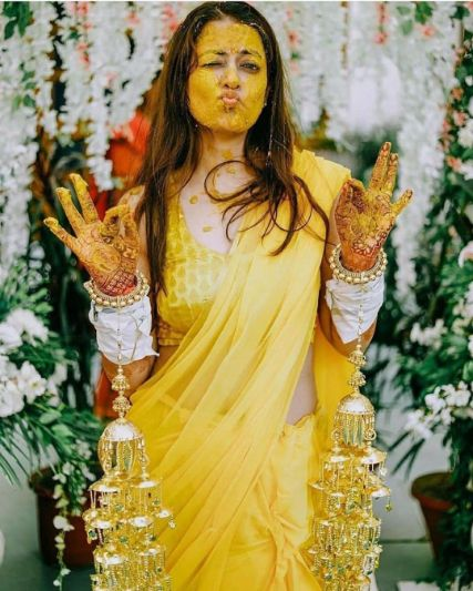 cute photo of a bride on her haldi ceremony | Wedding Trends for Haldi Ceremony