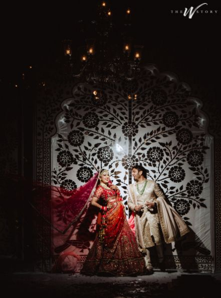 bride and groom posing for their wedding pictures | Destination Wedding in Jaipur