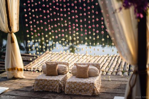 couple wedding seat adorned with floers | wedding in Kerala