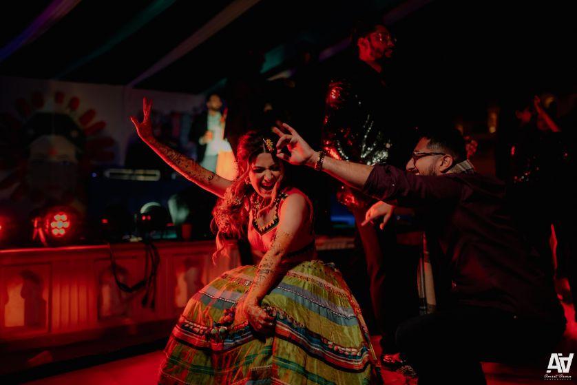 indian bride dancing on her mehendi ceremony