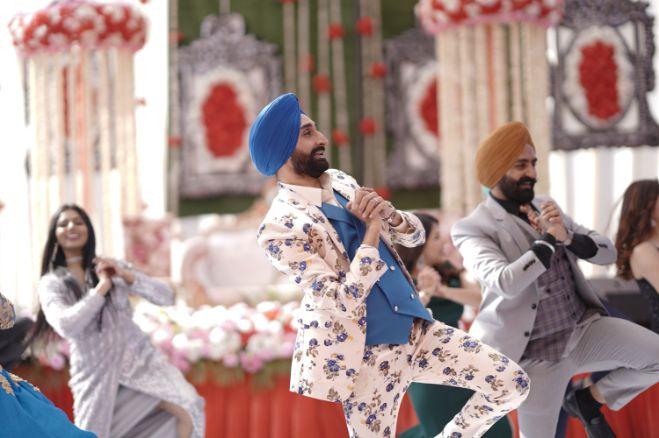 indian groom dancing with groomsmen