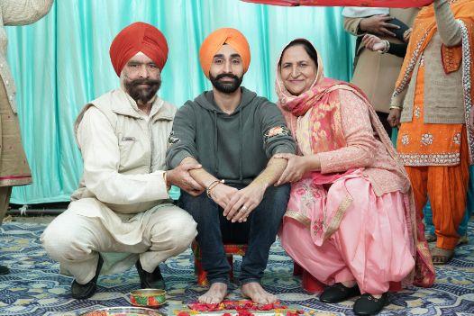 groom with his parents | indina wedding